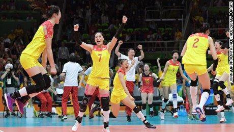 China's players celebrate after winning their women's gold medal volleyball match against Serbia on August 20, 2016, at the Rio 2016 Olympic Games.