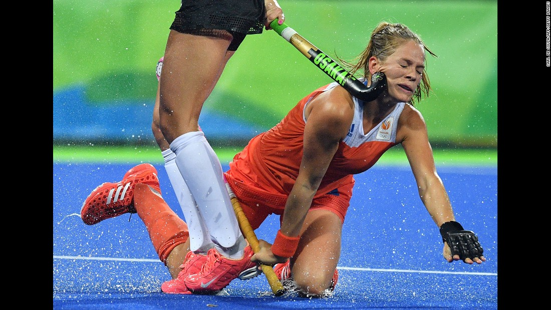 Dutch field hockey player Kitty van Male catches a stick to the face during a quarterfinal match against Argentina on Monday, August 15.