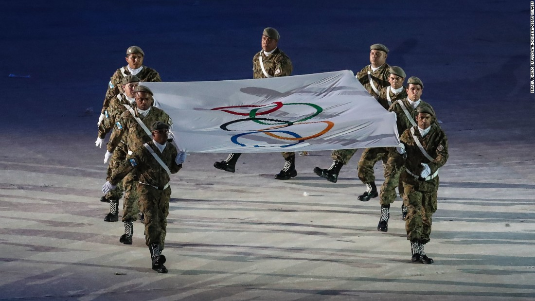 The Olympic flag is carried to the stage during the closing ceremony on Sunday, August 21.