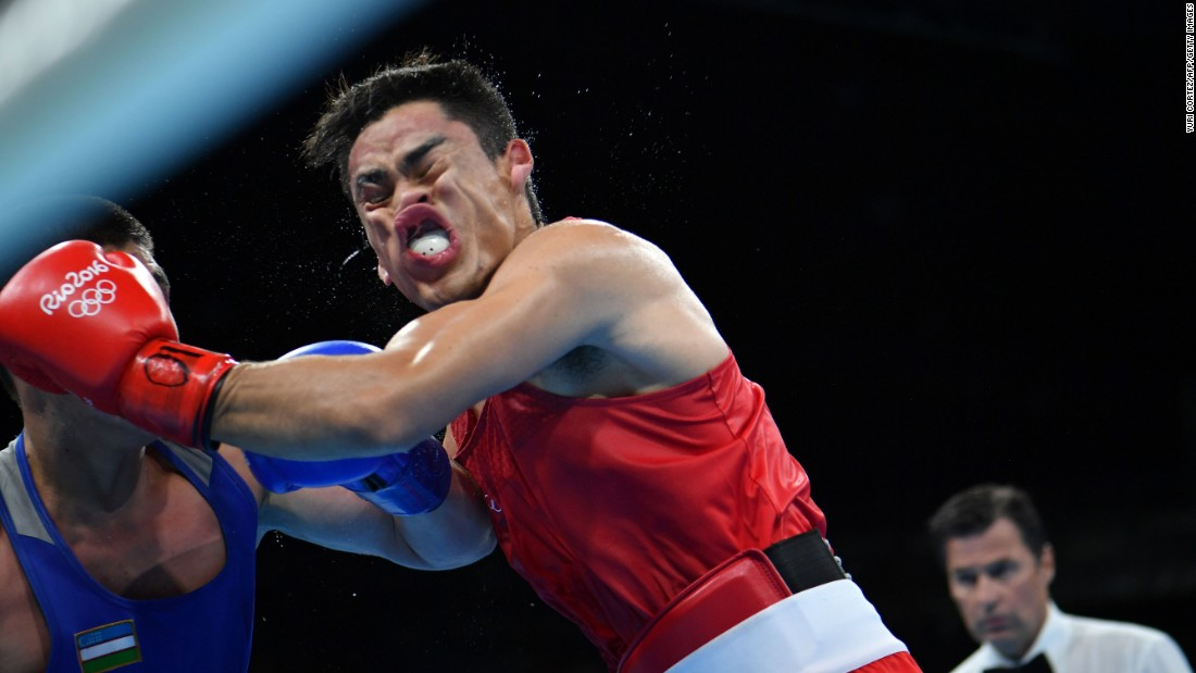 Mexican boxer Misael Uziel Rodriguez, right, is punched by Uzbekistan's Bektemir Melikuziev during a middleweight semifinal on Thursday, August 18. Melikuziev won the bout and finished with the silver medal. Rodriguez ended up with the bronze.