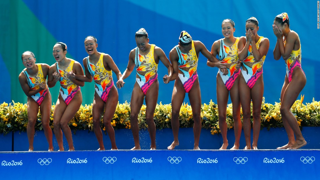 Japan's synchronized swimming team celebrates on the podium after winning bronze on Friday, August 19.