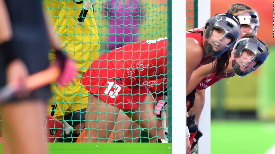 British field hockey players defend their goal during the gold-medal match against the Netherlands on Friday, August 19. They won in a shootout.
