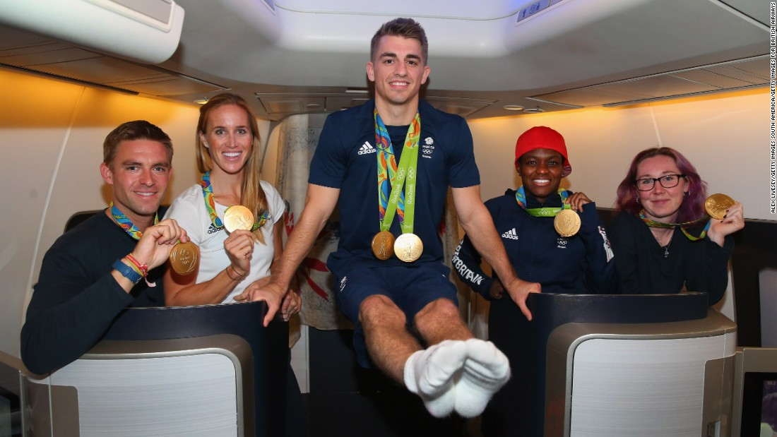 With the flight stocked with champagne and all the athletes offered a three-course meal, Team GB were in high spirits as they returned home. Max Whitlock shows there's no Olympic hangover, demonstrating his pommel horses moves alongside Nicola Adams, rower Pete Reed and cyclist Katie Archibald.