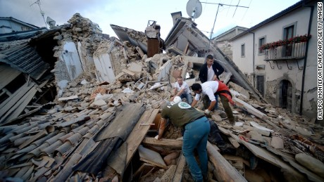 Resident search for victims in the rubble after a strong heartquake hit Amatrice on August 24, 2016 Central Italy was struck by a powerful, 6.2-magnitude earthquake in the early hours, which has killed at least three people and devastated dozens of mountain villages. Numerous buildings had collapsed in communities close to the epicenter of the quake near the town of Norcia in the region of Umbria, witnesses told Italian media, with an increase in the death toll highly likely. / AFP PHOTO / FILIPPO MONTEFORTEFILIPPO MONTEFORTE/AFP/Getty Images