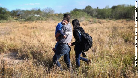 RIO GRANDE CITY, TX - DECEMBER 07:  A father carries his sleeping son, 3, after their family illegally crossed the U.S.-Mexico border on December 7, 2015 near Rio Grande City, Texas. The father said he was bringing his family from Guanajuato, Mexico to settle in San Antonio, Texas. They were detained by the U.S. Border Patrol. The number of migrant families and unaccompanied minors crossing the border has surged in recent months, even as the total number of illegal crossings nationwide has gone down from the previous year.  (Photo by John Moore/Getty Images)