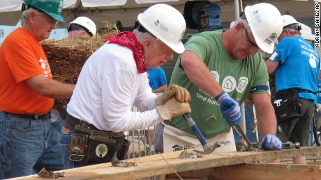 Former President Jimmy Carter, center, works on a Habitat for Humanity construction project in Memphis.