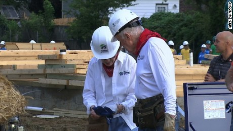 Jimmy Carter and his wife, Rosalynn Carter, work in Memphis.