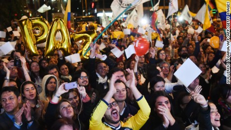 Colombians celebrate as they watch on a giant screen broadcasted from Havana, Cuba, the signing of agreement of conclusion of the peace talks between the Colombian Government and FARC guerrilla, on August 24, 2016, in Bogota.  Colombia's government and FARC rebels announced Wednesday that they have reached a historic peace accord to end their half-century civil war, the last major armed conflict in the Americas. / AFP / GUILLERMO LEGARIA        (Photo credit should read GUILLERMO LEGARIA/AFP/Getty Images)