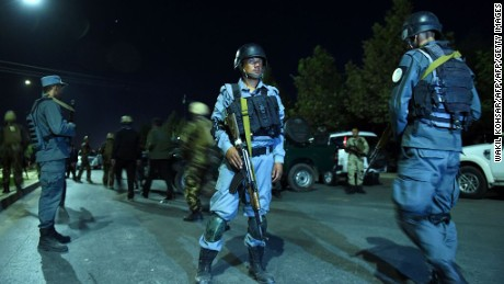 Security personnel stand guard Wednesday night at the American University of Afghanistan in Kabul.