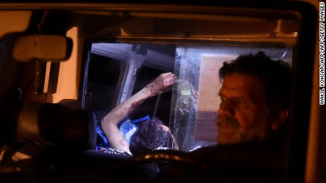 An injured Afghan man lies on a stretcher in an ambulance after Wednesday night's attack.