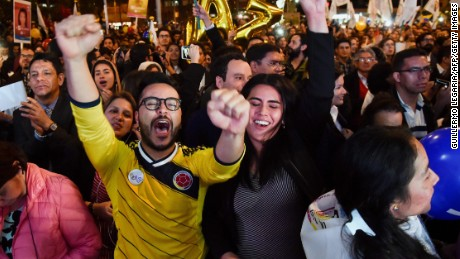 Colombians celebrate as they watch on a giant screen broadcasted from Havana, Cuba, the signing of agreement of conclusion of the peace talks between the Colombian Government and FARC guerrilla, on August 24, 2016, in Bogota.  Colombia's government and FARC rebels announced Wednesday that they have reached a historic peace accord to end their half-century civil war, the last major armed conflict in the Americas. / AFP PHOTO / GUILLERMO LEGARIAGUILLERMO LEGARIA/AFP/Getty Images
