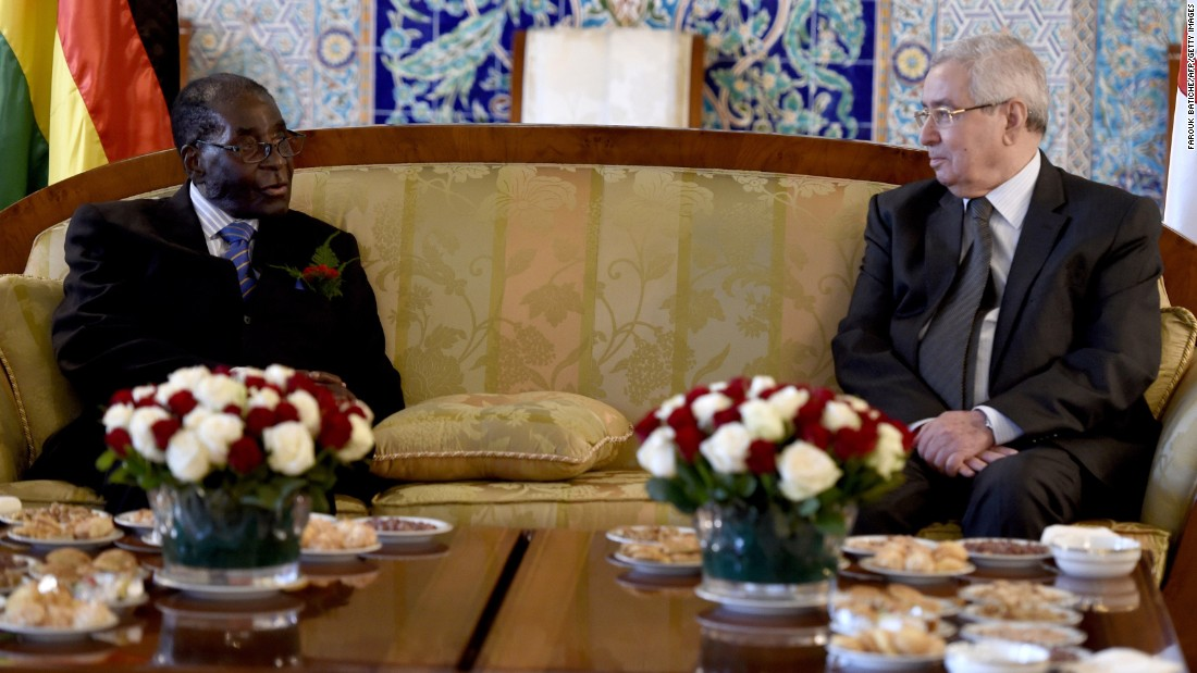 Abdelkader Bensalah, president of Algeria's Council of the Nation, welcomes Mugabe to his country's capital, Algiers, at the Houari Boumediene Airport in 2015.