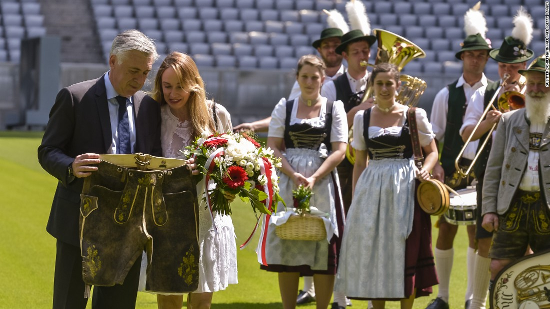 After his dismissal in only his second year at Real, Ancelotti took a break from football spending a year in Canada with wife Mariann, who he marred in 2014. Here, the pair inspect the traditional Bavarian lederhosen which they received in July as the Italian started work in his latest role at the serial German champion, Bayern Munich.