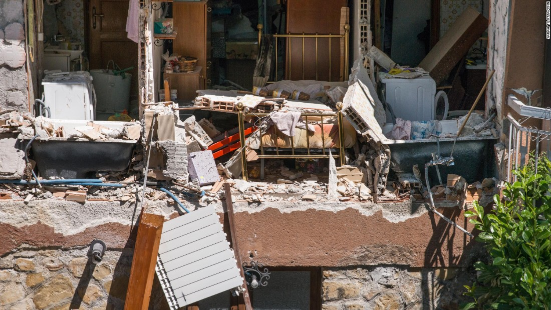 The destroyed interior of a home is seen in Amatrice.