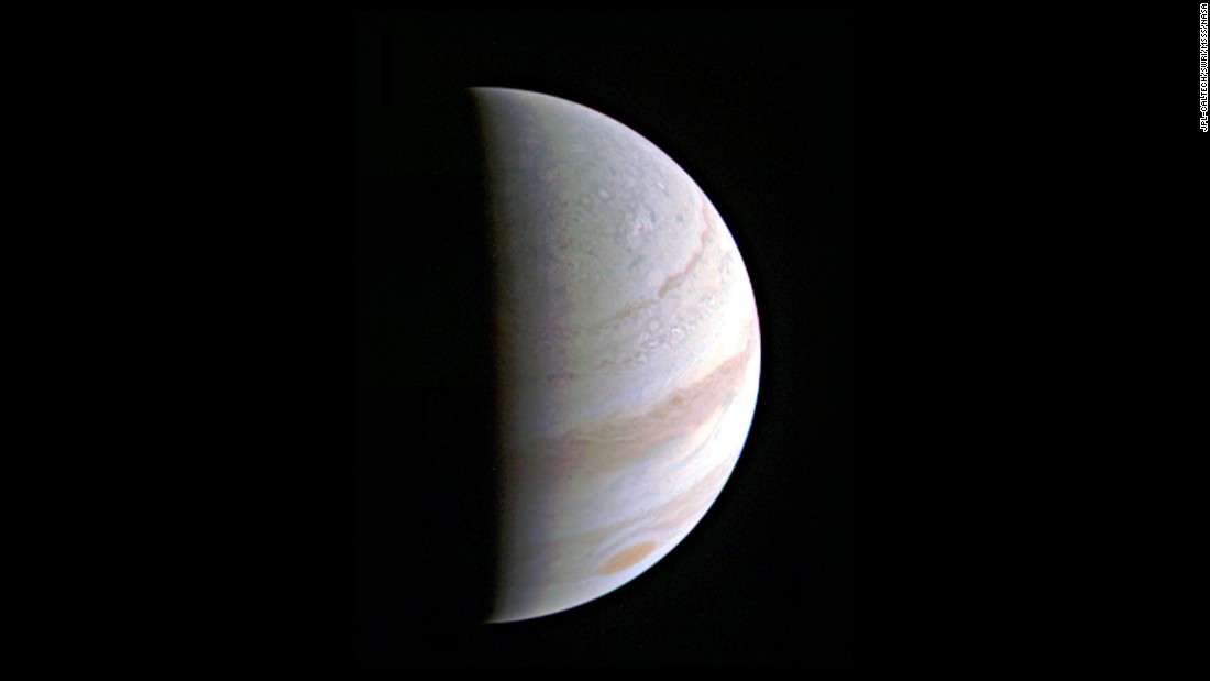 Jupiter's north polar region comes into view as NASA's Juno spacecraft approaches the giant planet. This view of Jupiter was taken Saturday, August 27, when Juno was 437,000 miles (703,000 kilometers) away during its first of 36 orbital flybys of the planet.