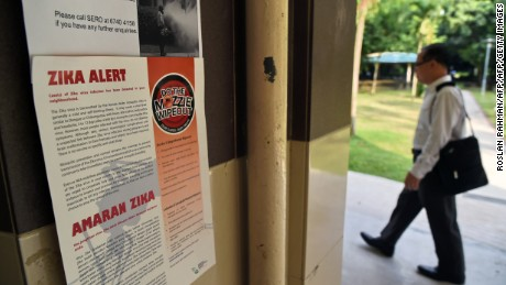 A Zika alert notice is seen posted at the lift landing area of a residential block in the Aljunied Crescent neighbourhood in Singapore on August 29, 2016.
