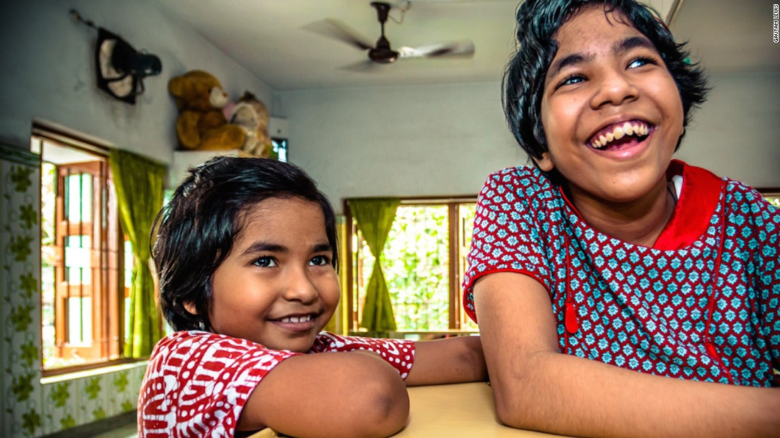 "Gautam photographed these sisters, who have stayed together as orphans at the children's home in the care of the Missionaries of Charity. ""I probably have brothers and sisters but I don't know who they are,"" says Gautam."