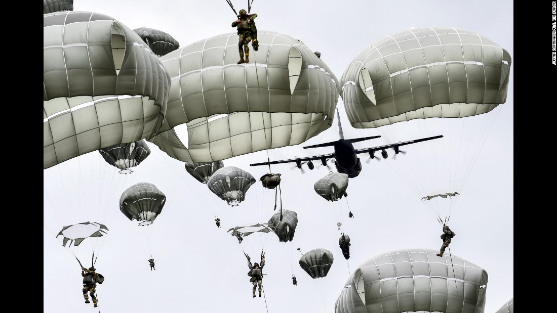 U.S. soldiers from the 25th Infantry Division conduct an airborne operation during a training exercise in Anchorage, Alaska, on Tuesday, August 23.