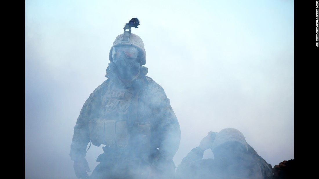U.S. Marine Maj. Christopher W. Simpson walks through tear gas during a training exercise in Australia's Northern Territory on Thursday, August 18. Australian and French forces also participated in the exercise, which simulated a chemical attack.