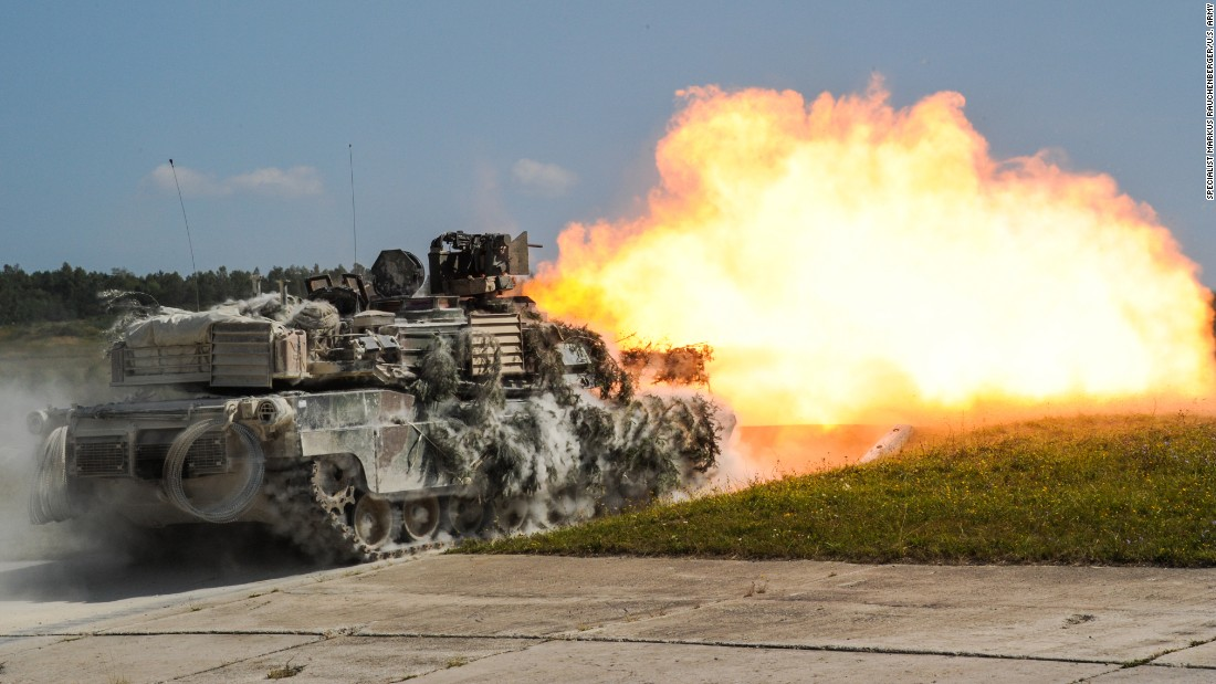 U.S. soldiers fire from a tank during a training exercise in Grafenwoehr, Germany, on Thursday, August 18. The exercise included more than 3,500 participants from 16 NATO and European partner nations.