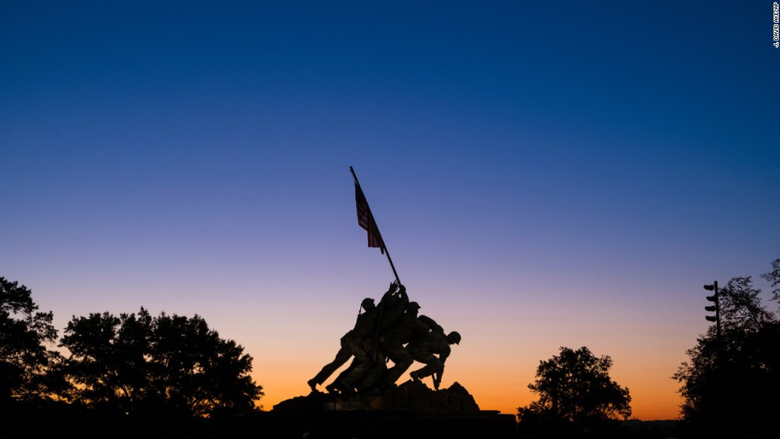 A sunrise silhouettes the U.S. Marine Corps War Memorial in Arlington, Virginia, on Tuesday, August 23.