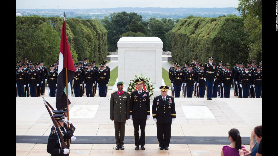 Lt. Gen. Hamad Mohammed Thani Al Rumaithy, chief of staff of the United Arab Emirates' armed forces, stands with U.S. Army Maj. Gen. John G. Ferrari, center, and U.S. Army Chief of Staff Mark A. Milley, right, after a wreath-laying ceremony at the Tomb of the Unknowns in Arlington, Virginia, on Friday, August 5.