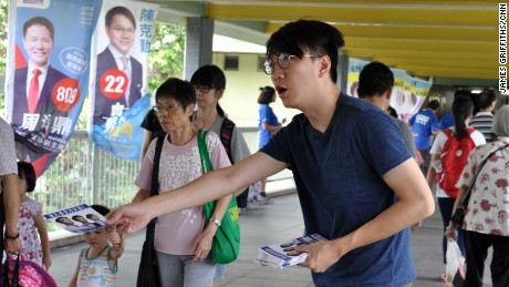Edward Leung hands out leaflets for Youngspiration candidate Baggio Leung in the New Territories East constituency.
