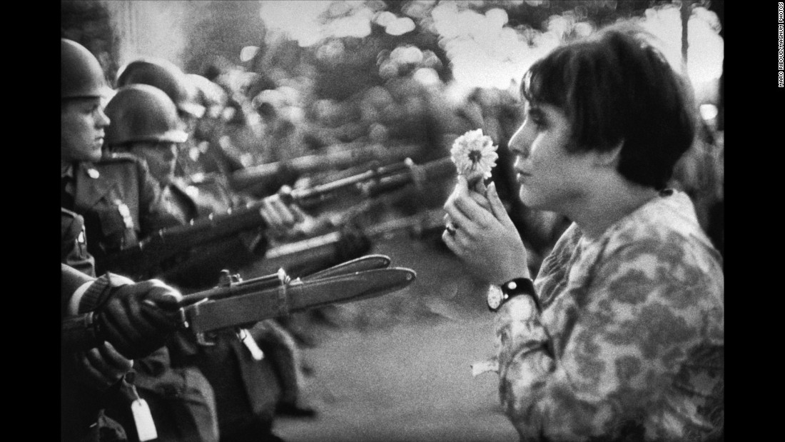 "Jan Rose Kasmir confronts National Guard troops with a flower during a Vietnam War protest outside the Pentagon in 1967. This is one of the most memorable anti-war images from that era. It was taken by Marc Riboud, an acclaimed French photographer who died this week at the age of 93. ""She was just talking, trying to catch the eye of the soldiers, maybe try to have a dialogue with them,"" Riboud recalled in the April 2004 issue of Smithsonian magazine. ""I had the feeling the soldiers were more afraid of her than she was of the bayonets."""