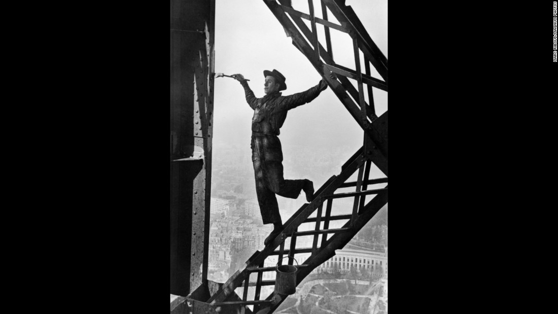 Another one of Riboud's famous photos is of a man named Zazou painting the Eiffel Tower in Paris in 1953.