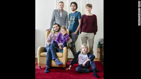 Edgar and Amelie Rai and their children, Nelly and Moritz, welcomed Syrian brothers, Bilal (seated) and Amr Aljaber.