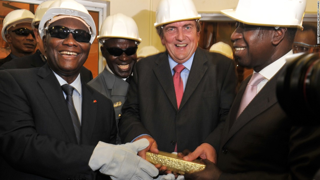 Ivorian President Alassane Ouattara, CEO of the Randgold Resources Marc Bristow and Ivorian Mines Minister Adama Toungara hold a gold bar coming from the Tongon gold mine during the official inauguration of the facility in 2011.  <br /><br />Ouatarra is a strong supporter of the gold industry and has encouraged growth through tax incentives for mining firms.