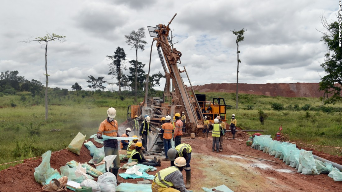 Employees at work at the Agbaou gold mine in the South of the country, which opened in 2014 and is operated by Canadian company Endeavour Mining. The mine has around 850 employees.