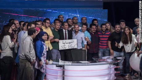 "Youssef and his team hold a card that reads ""the end"" in Arabic to announce the end of ""Al-Bernameg"" in Cairo, Egypt on June 2, 2014."