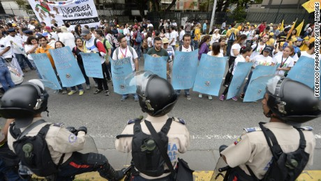 Venezuelan police face off against demonstrators before an opposition march Thursday in Caracas.