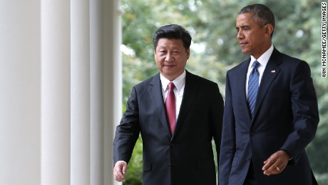 US President Barack Obama and Chinese President Xi Jinping arrive for a joint press conference in the Rose Garden at the White House on September 25, 2015.