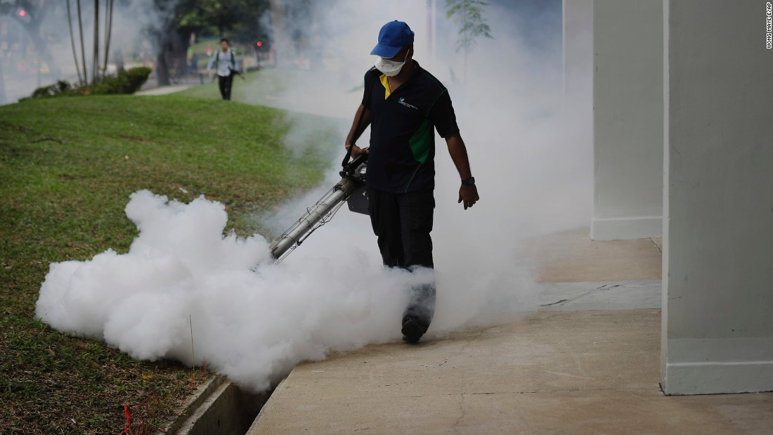 A pest control worker fumigates drains at a local housing estate where the latest case of Zika infections were reported on Thursday, September 1, in Singapore.