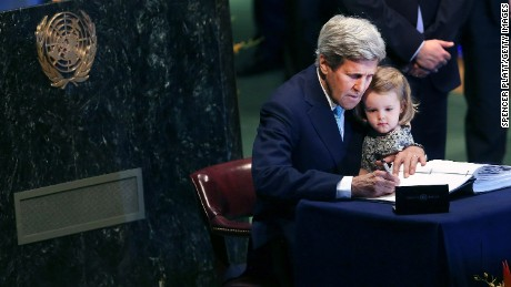 Secretary of State John Kerry holds his two year-old grand daughter Isabel Dobbs-Higginson for the signing of the accord at the United Nations Signing Ceremony for the Paris Agreement climate change accord in April 2016 in New York City.