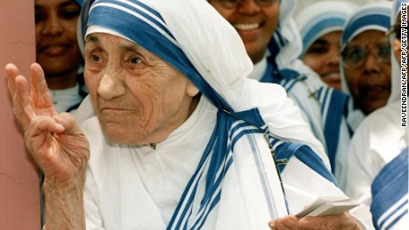 NEW DELHI, INDIA:  (FILES) In this file picture taken, 15 May 1997, Mother Teresa stands with nuns of the Missionaries of Charity For Destitute Children in New Delhi.  Mother Teresa will be beatified, 19 October 2003, in a ceremony in St Peter's Square, Vatican. The beatification ceremony is the penultimate step to being canonised a saint and has been the shortest in modern history. Following the beatification, a second miracle has to be verified by the Vatican before Mother Teresa can be proclaimed a saint.   AFP PHOTO/RAVEENDRAN  (Photo credit should read RAVEENDRAN/AFP/Getty Images)