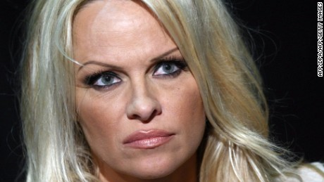 Canadian actress Pamela Anderson (L) and Canadian animal rights activist Paul Watson (R) listen during a press conference where Anderson  manifested her support for the Sea Shepherd Conservation Society founder in Frankfurt am Main in western Germany on June 13, 2012.  Watson is on bail while German authorities decide whether he can be extradited to Costa Rica on charges stemming from a high-seas confrontation over shark finning in 2002.  AFP PHOTO / FREDRIK VON ERICHSEN     GERMANY OUT        (Photo credit should read FREDRIK VON ERICHSEN/AFP/GettyImages)