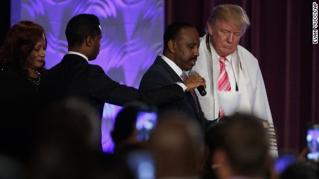 By inviting Trump, black pastor gives bigot access to his flock