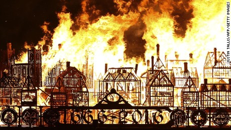 A replica of 17th-century London on a barge floating on the river Thames burns in an event to mark the 350th anniversary of the Great Fire of London, in London on September 4, 2016. A giant replica of 17th-century London was set ablaze on the Thames in the city to mark the 350th anniversary of the devastating Great Fire of London. The 1666 inferno destroyed most of the walled inner city dating back to Roman times -- a bustling, congested maze of tightly-packed wooden houses. It forced London to rebuild anew from the ashes.  / AFP / JUSTIN TALLIS        (Photo credit should read JUSTIN TALLIS/AFP/Getty Images)
