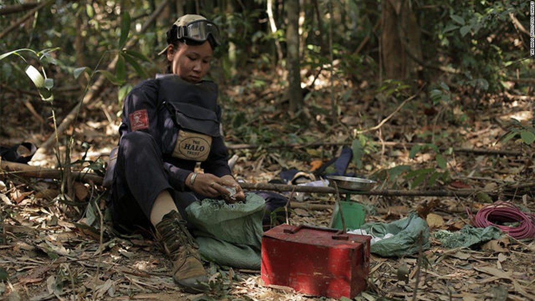 Ms Toyota, one of HALO's team leaders, prepares what she needs to conduct the demolition of a cluster munitions.