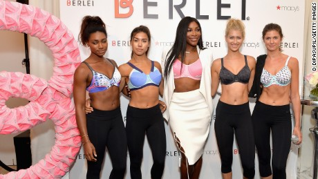 Serena Williams poses with models during a sports bra launch at Macy's in August. Williams is a favorite face for fashion and beauty brands.
