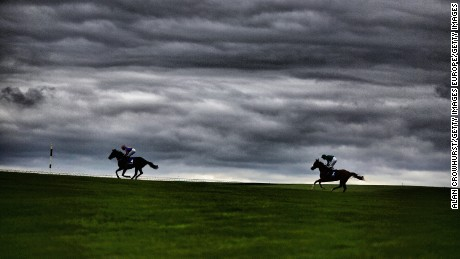 Runners make their way across the centre of the track at Curragh Racecourse.