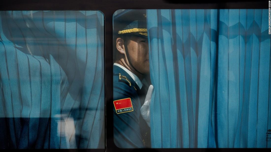 "An honor guard looks out a bus window ahead of US President Barack Obama's arrival in Hangzhou, China, on Saturday, September 3. World leaders were gathering in the city for the 11th G-20 Summit. <a href=""http://www.cnn.com/2016/09/02/world/gallery/week-in-photos-0902/index.html"" target=""_blank"">See last week in 35 photos</a>"