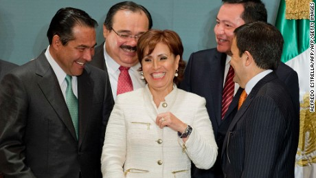 Mexico City's former mayor Rosario Robles (C) is surrounded by Luis Enrique Miranda Nava (L), Carlos Ramirez Marin (2-L), Miguel Angel Osorio Chong (2-R) and Ildefonso Guajardo after Mexico's President-elect Enrique Pena Nieto presented his transition team -- with members of the current government and the future one, towards his inauguration on December 1 -- in a press conference in Mexico City on September 4, 2012.   AFP PHOTO/Alfredo ESTRELLA        (Photo credit should read ALFREDO ESTRELLA/AFP/GettyImages)