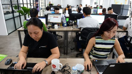 This picture taken on September 5, 2016 shows employees working inside the French IT company Linkbynet in Ho Chi Minh City. A decade ago app technology would likely have been developed in California's Silicon Valley, but today those apps are being churned out by Vietnam's startup sector -- an industry driven by local techies trained overseas but returning home to prowl for opportunities.   / AFP / STR / TO GO WITH Vietnam-technology-economy-startups,FOCUS by Hervé ASQUIN, with Jenny VAUGHAN in Hanoi         (Photo credit should read STR/AFP/Getty Images)