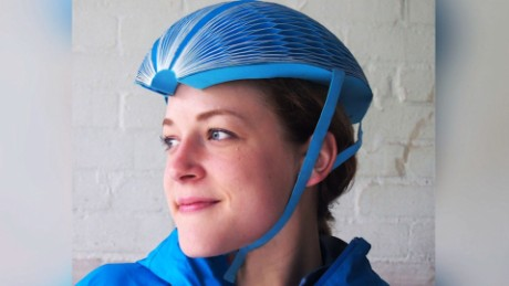 NS Slug: WOMAN CREATES FOLDABLE BIKE HELMET OUT OF PAPER  Synopsis: A paper helmet may be next best thing in bike share program.  Keywords: BIKE RIDE SHARE HELMET