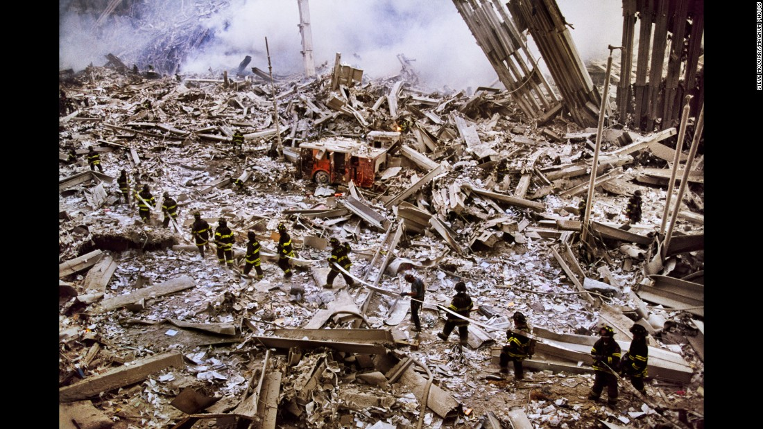 Steve McCurry captures a procession of firefighters entering ground zero.