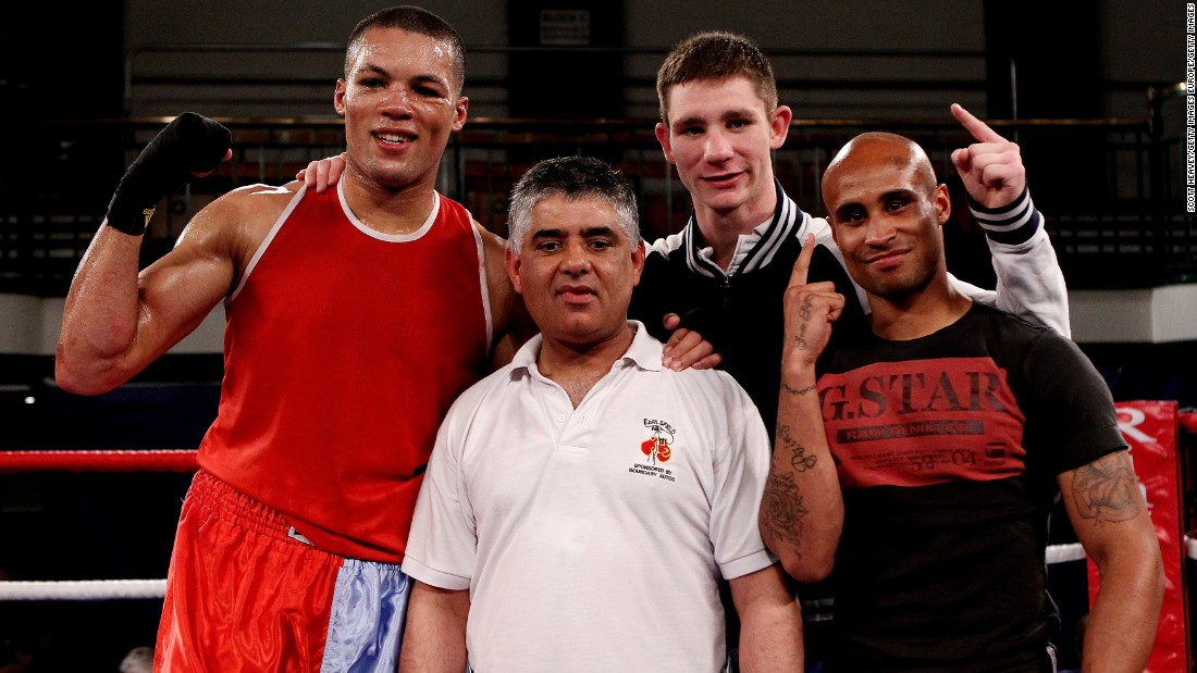 Khan (middle) is flanked by winning fighters Joe Joyce (L), Kirk Garvey (C) and Louis Adolphe (R) after a victorious night for Earlsfield at the 2012 ABA Elite Championship Finals at York Hall in east London.
